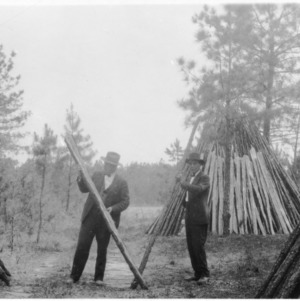 J. H. Frye and other at farm woodlot thinning demonstration