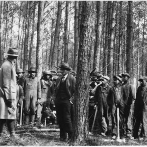 County Agent J. B. Britt conducting class on wood-cutting and timber thinning
