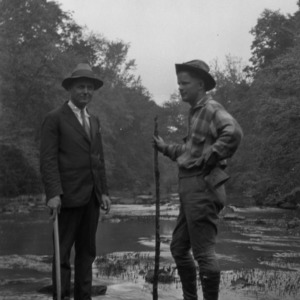 Two men at stream