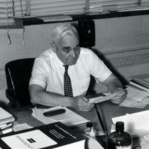 Alfred J. Stamm at desk