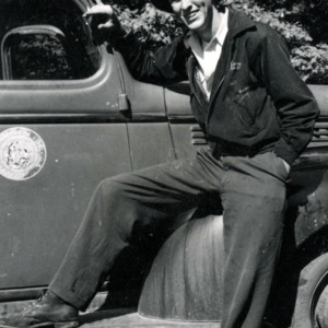 Man leaning on vehicle