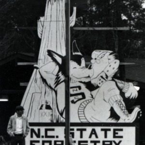 Man in front of N. C. State Forestry sign
