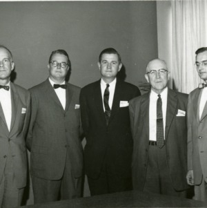 Group photograph of five men in suits