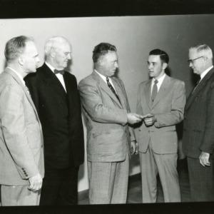Dick Preston, Carey H. Bostian, and three other men
