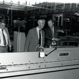 Kurt Waldthausen, Dean Eric Ellwood, and Gero Sassenburg examining edge bander machine