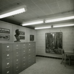 Faculty room with file cabinets and bust