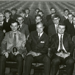 Xi Sigma Pi sitting in auditorium
