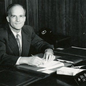 Dr. R. J. Preston at desk