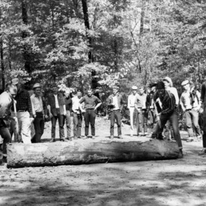 Forestry students participate in log rolling at Hill Forest
