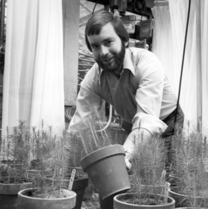 Forestry student with plants