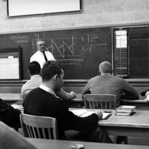 Professor George E. Tucker lectures on furniture manufacturing controls