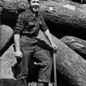 Forestry student works with logs