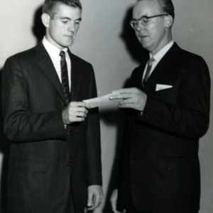 Dr. Joseph King awarding Norman A. Russell with a scholarship