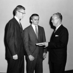 Dr. Joseph King awarding Kindred P. Magette and William H. Poole with the William J. Bridges Honorial Scholarship