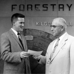 Two men in front of Kilgore Hall