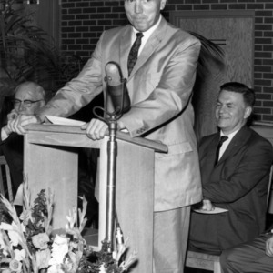 John Caldwell at podium
