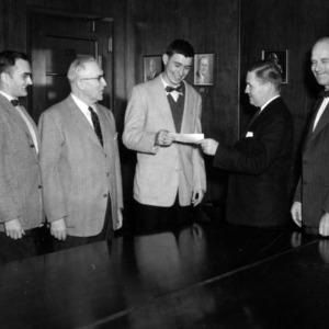 Five men with certificate