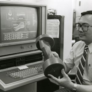 Dr. Han P. Bao with shoe last designed with computer-aided techniques