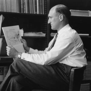 Charles E. Bishop examining map