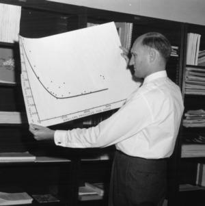 Charles E. Bishop examining chart