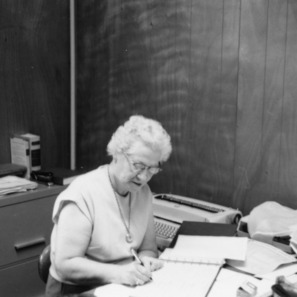 Dessie Bishop at desk