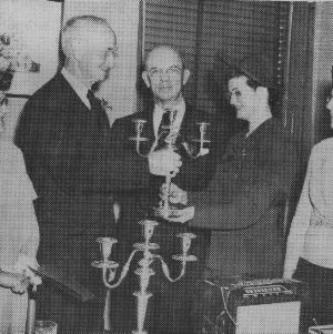 Thomas E. Browne, his wife, and others at his retirement party