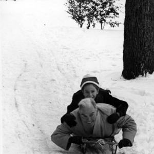 John T. Caldwell sledding with daughter