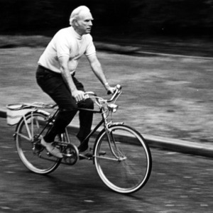 John T. Caldwell riding bike