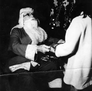 John T. Caldwell as Santa at Christmas