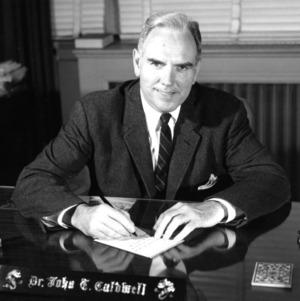 Dr. John T. Caldwell at desk