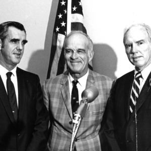 John T. Caldwell and others at microphone