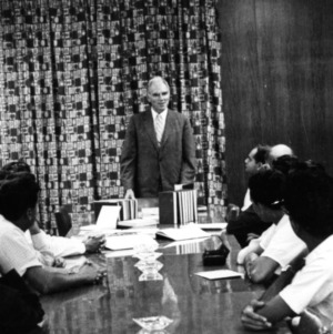 John T. Caldwell at meeting