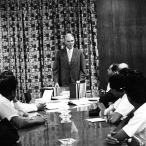 John T. Caldwell at meeting