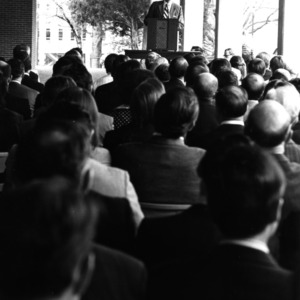 John T. Caldwell giving speech at meeting