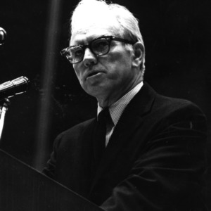 John T. Caldwell giving speech at podium