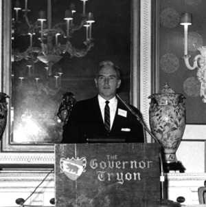 John T. Caldwell giving speech at podium