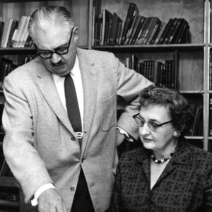 Dean Malcolm E. Campbell and woman examining document