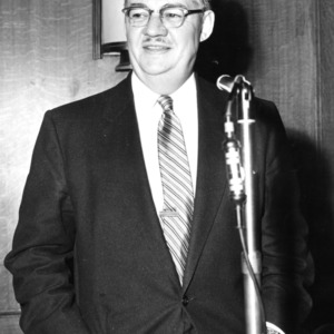 Malcolm E. Campbell at microphone
