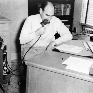 Victor S. Carson using dictation machine