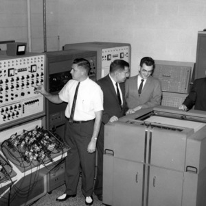 John W. Cell and others in lab