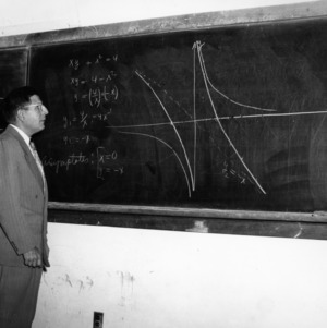 Dr. John W. Cell teaching at chalkboard