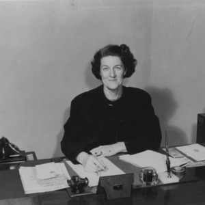 Miss Ruth Current at desk