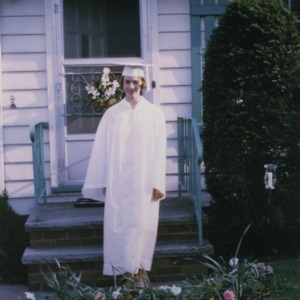 Marye Ann Fox in graduation robes