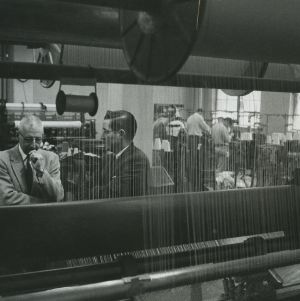 William C. Friday and others in textile laboratory