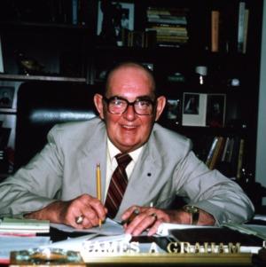 James A. Graham at desk
