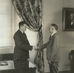 John W. Harrleson and Frank P. Graham shaking hands