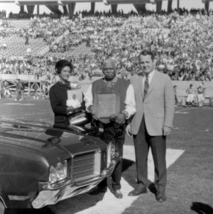 Chester Grant and others in stadium