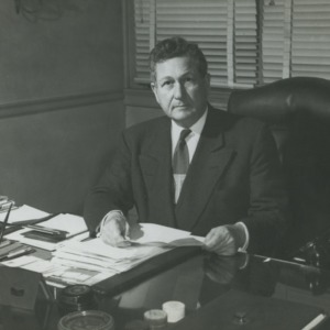 John W. Harrelson at desk