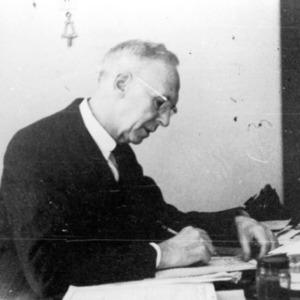 C. D. Hart writing at desk