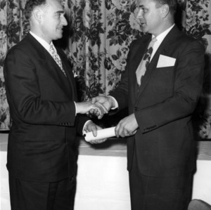 Dr. Victor S. Carson accepting certificate from Dr. George B. Hoadley